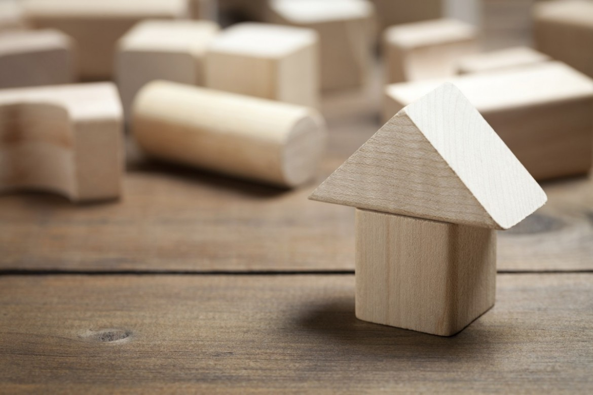 Wooden Houses toy on old table with lift roof